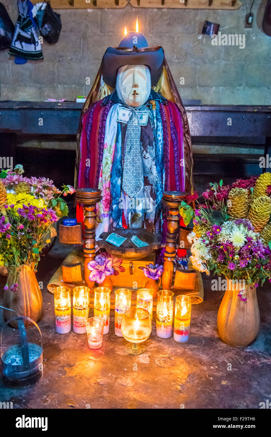 Shrine of El Maximon in Santiago De Atitlan , Guatemala  Maximon saint/devil is one of the strongest remnants of - Stock Image