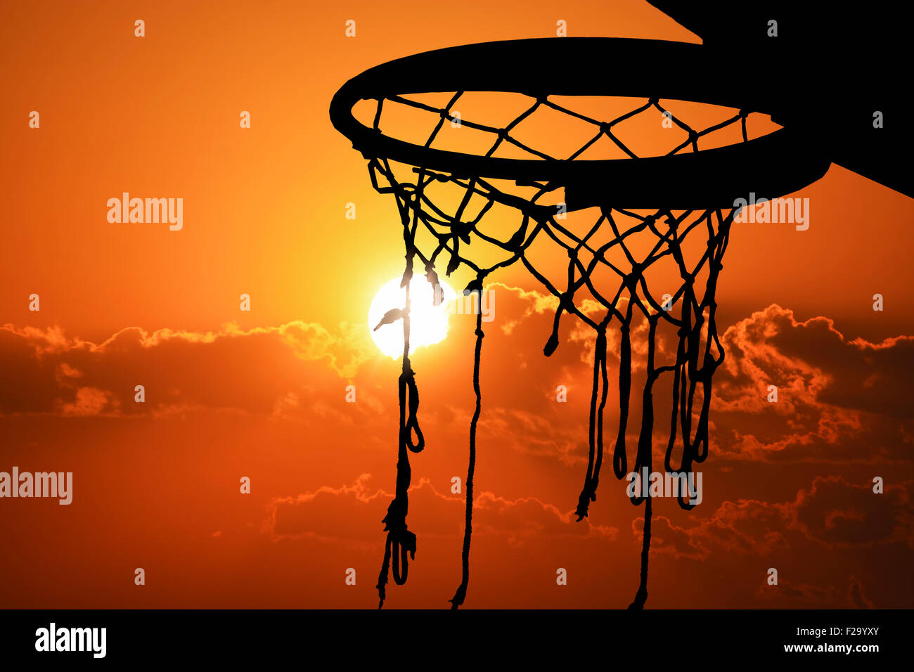 Basketball hoop outdoor in the sunset silhouette - Stock Image