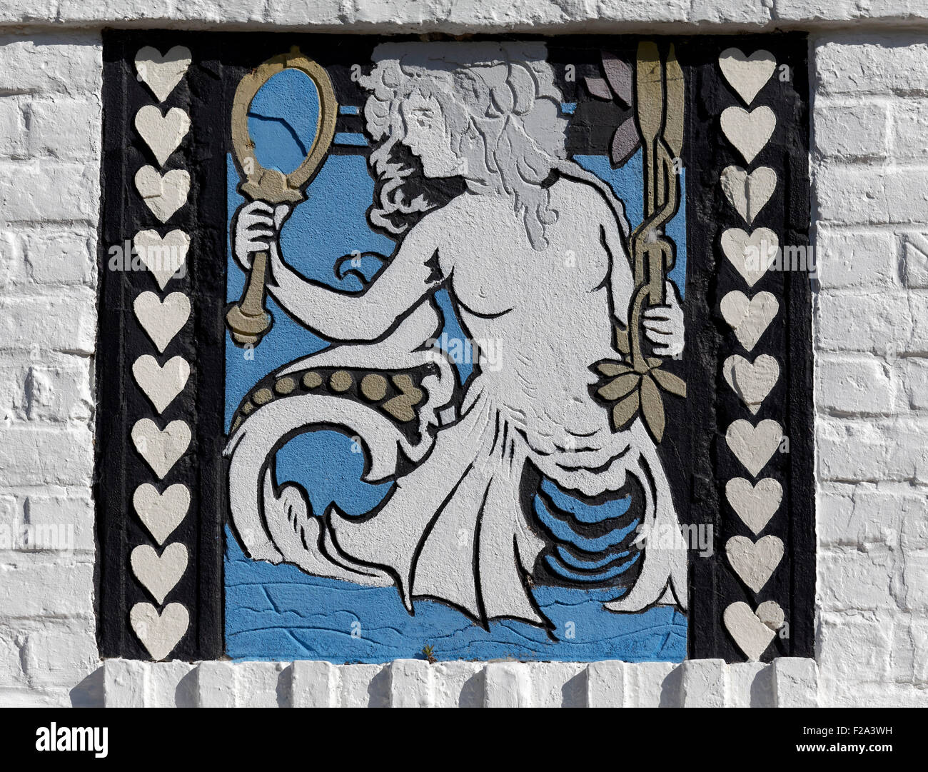 Mermaid looks in the mirror, sgraffito on a villa from 1926, historic uptown de Concessie, seaside resort De Haan, - Stock Image