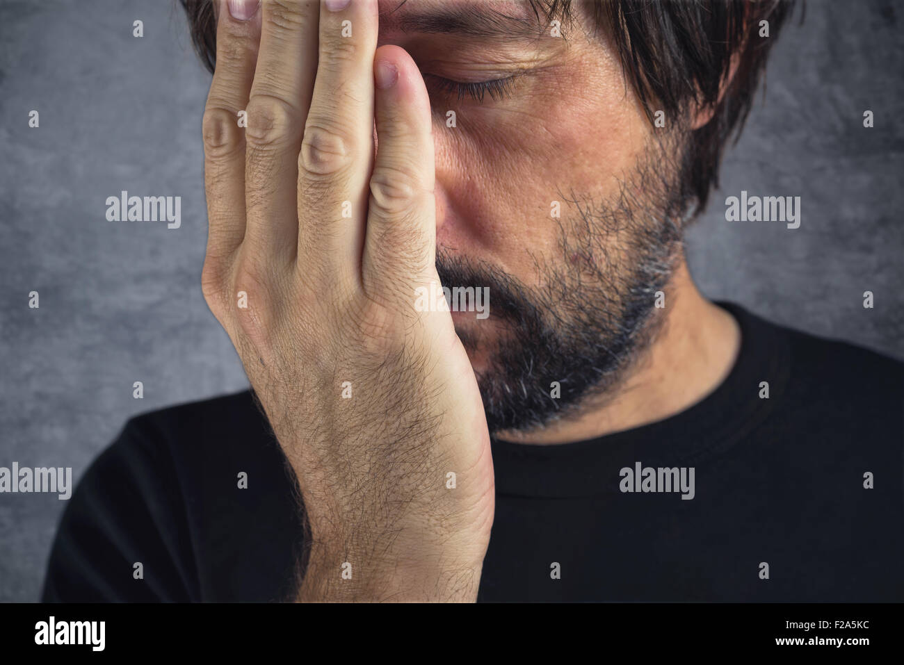 Portrait of man in trouble, problems in life - Stock Image