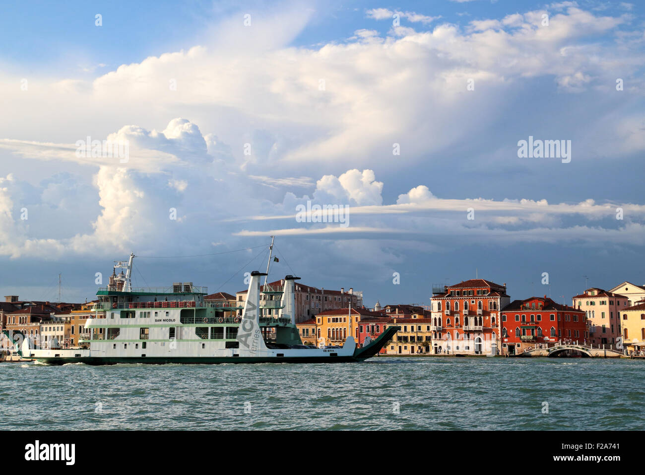 Cloud formations at Fondamenta delle Zattere waterfront. Actv ferry 'San Nicolo', IMO  9198422, going from - Stock Image