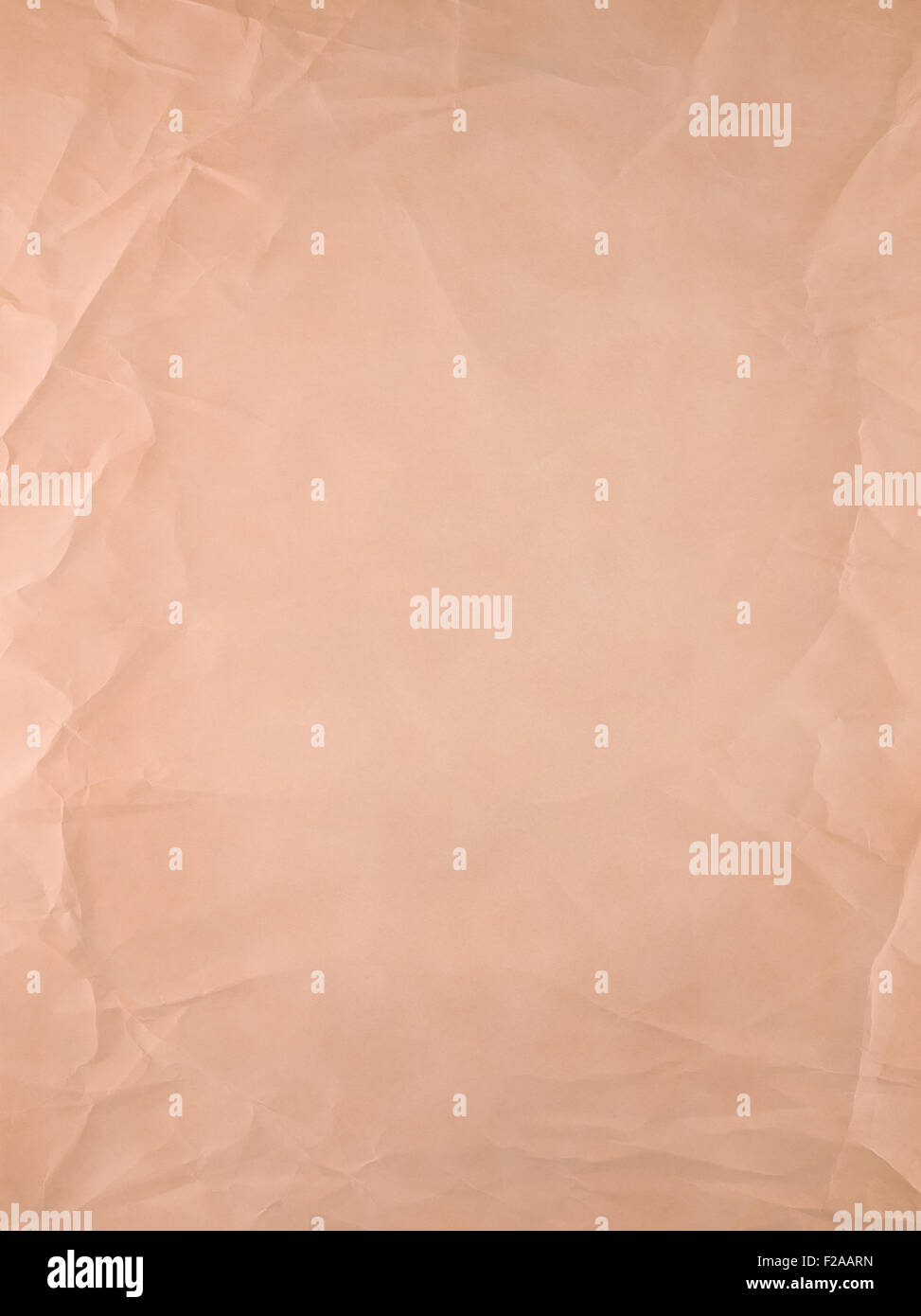 Orange old type paper, creases and wrinkles. - Stock Image