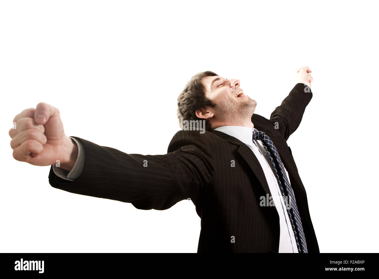 Happy businessman expressing success and victory concept - Stock Image