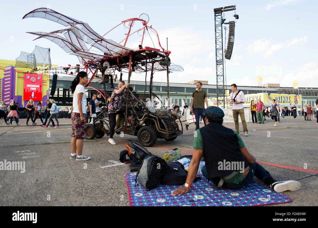 Berlin, Germany. 12th Sep, 2015. Performance artists drive with steampunk vehicles through a crowd of visitors during - Stock Image