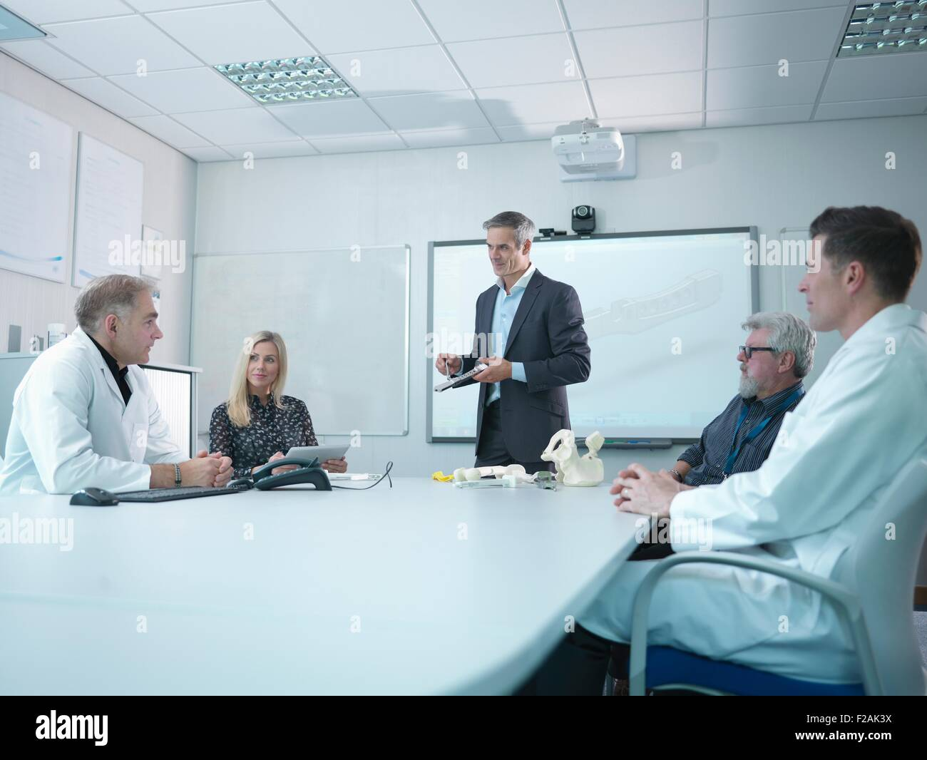 Medical product designers in presentation about orthopaedic product designs - Stock Image