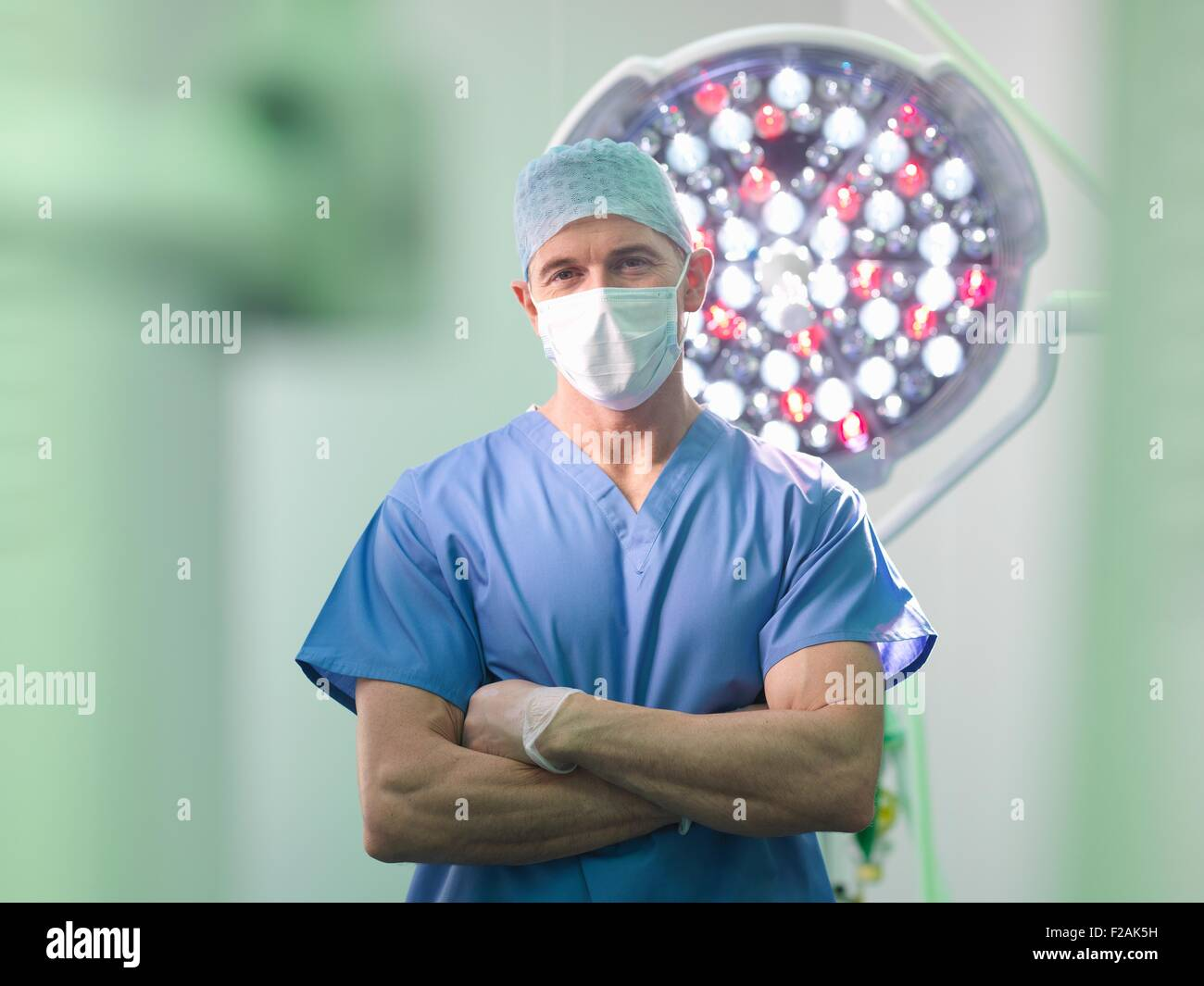 Orthopaedic surgeon in operating theatre, portrait - Stock Image