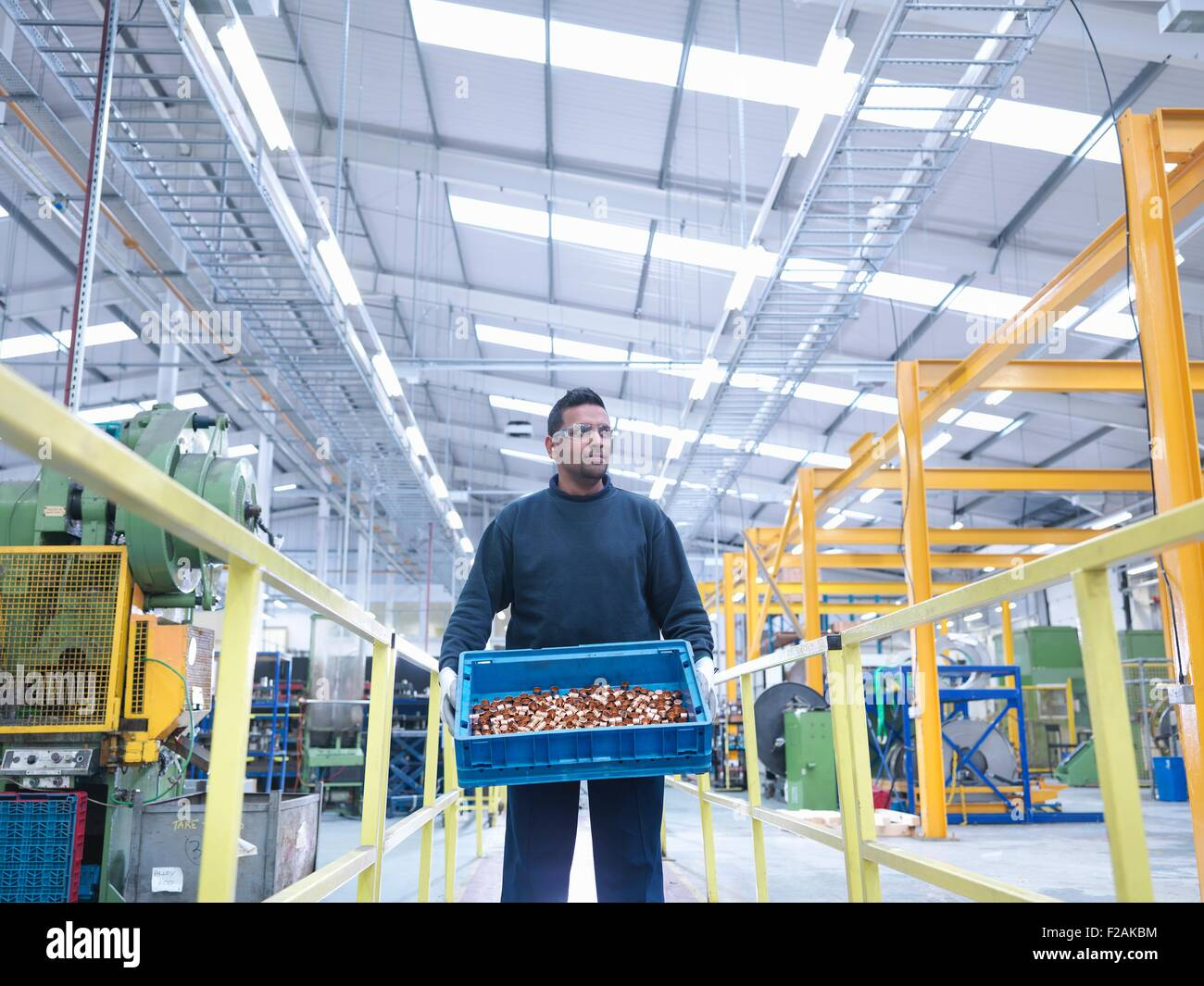Engineer carrying product in engineering factory - Stock Image