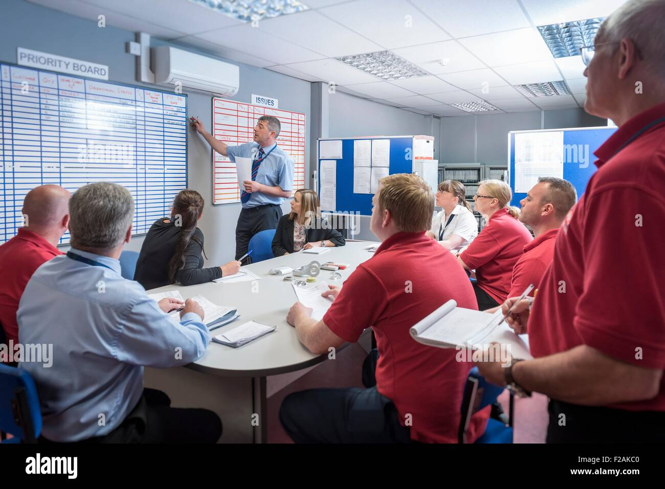 Production meeting in engineering factory - Stock Image