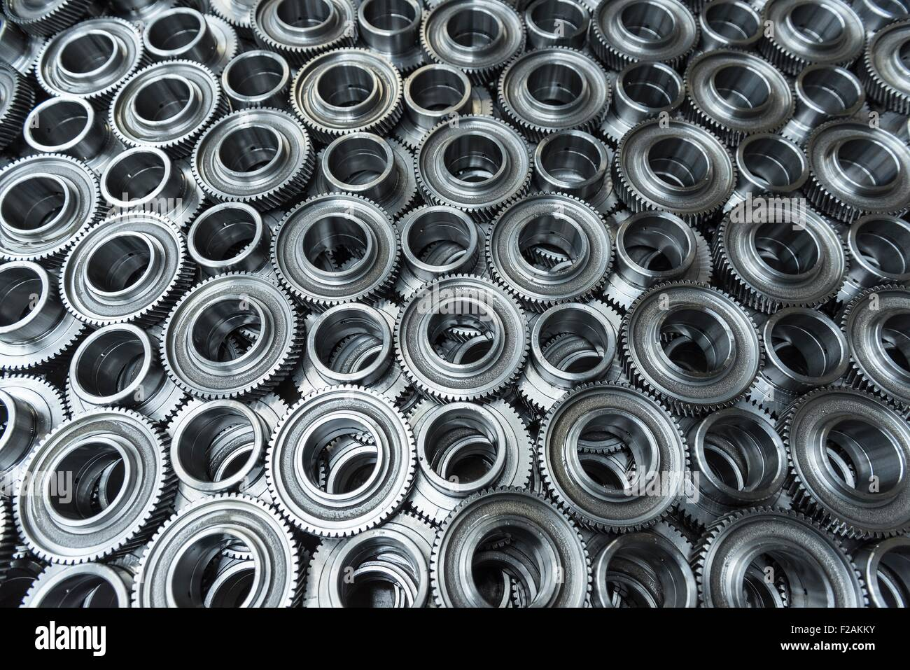 Gear wheels in production in engineering factory - Stock Image