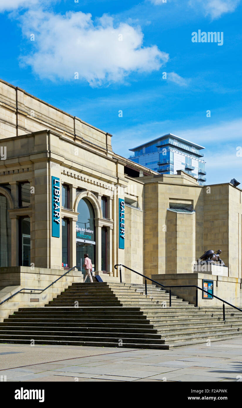 Man walking into Leeds Library and Art Gallery, the Headrow, Leeds, West Yorkshire, England UK Stock Photo