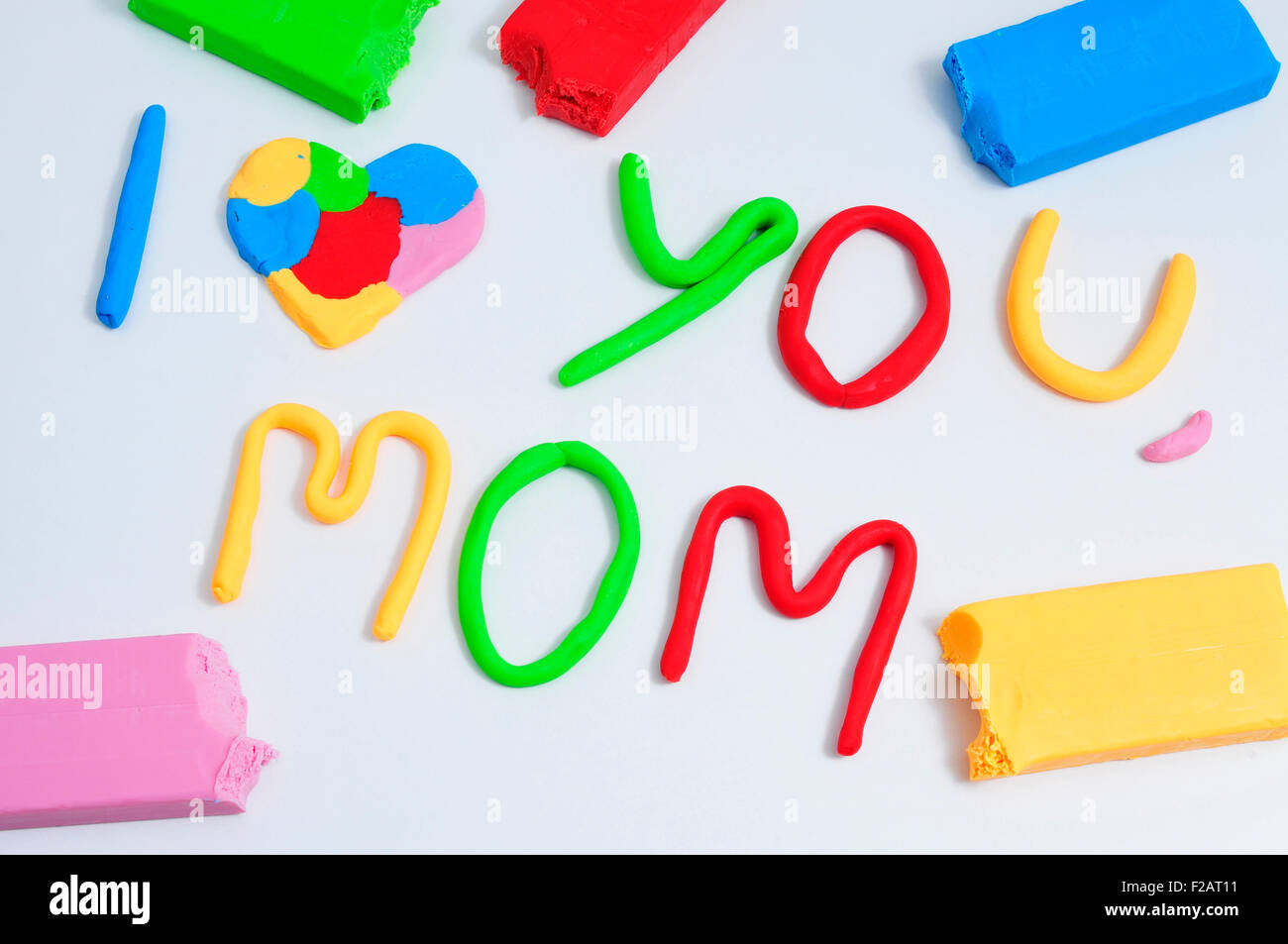 the sentence I love you mom, made in modeling clay of different colors - Stock Image
