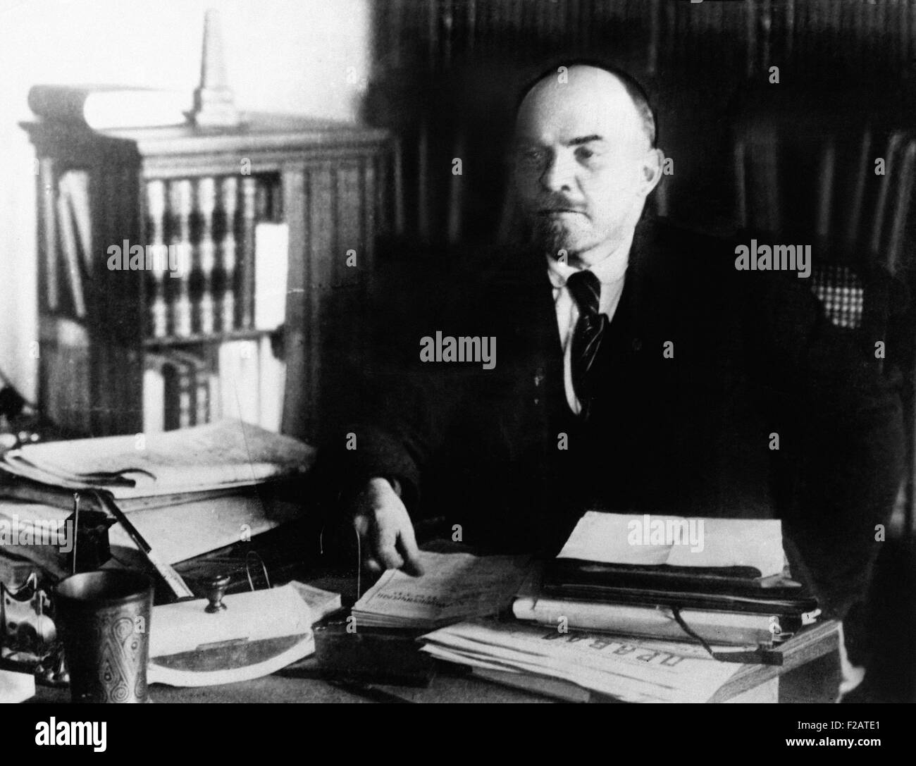 Vladimir Lenin, at his desk between 1920 to 1922. He was the head of the government of Revolutionary Russia from - Stock Image