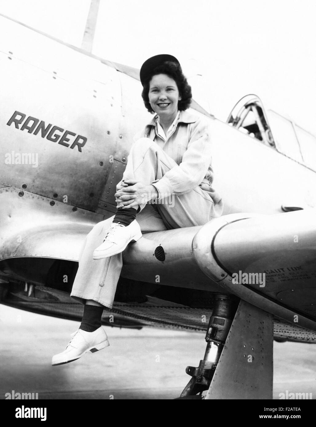 Margaret (Mickey) McGrath, former WASP sitting on the wing of in an XAT-6E trainer aircraft. It was equipped with - Stock Image