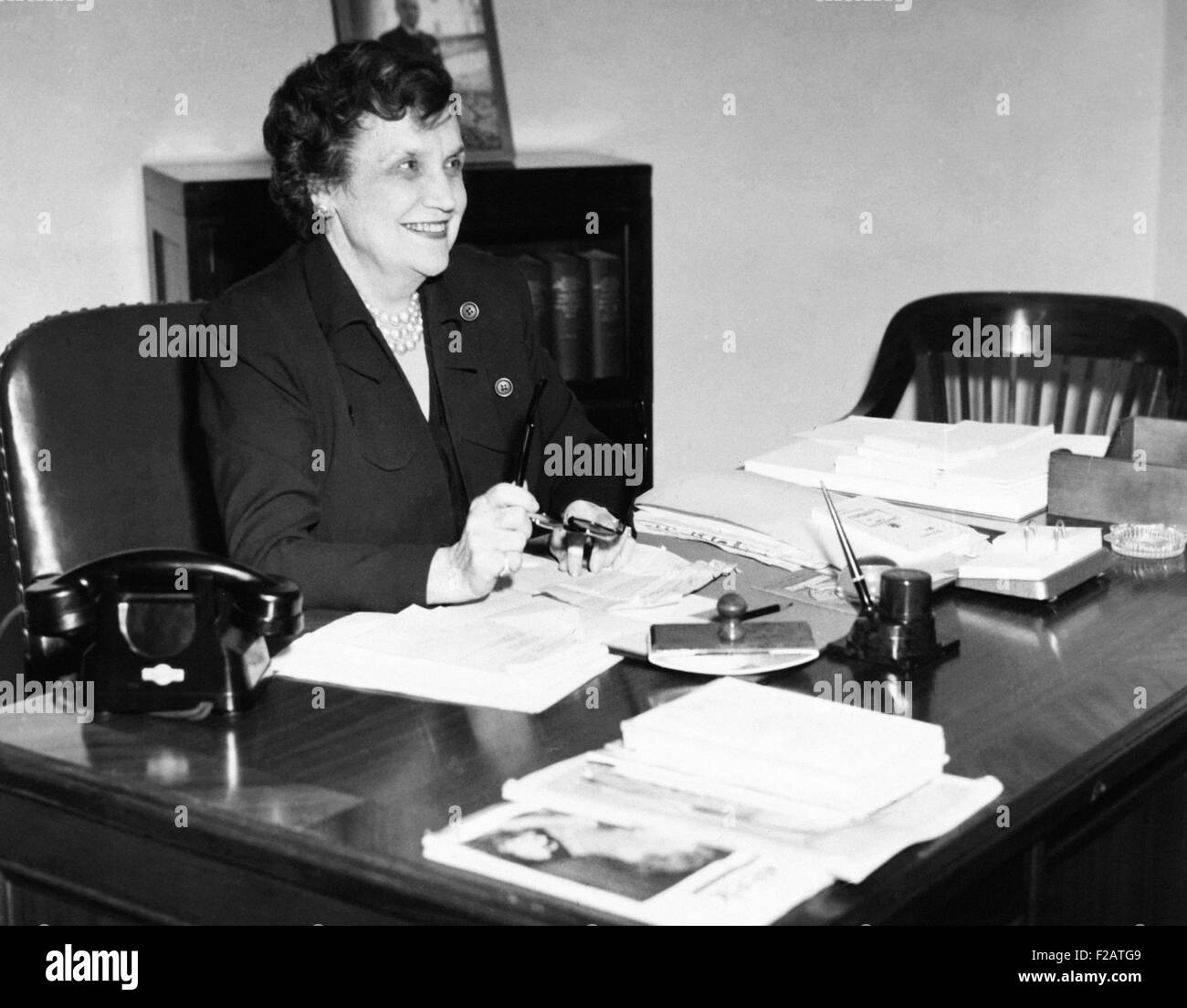 Pearl Mesta, Washington, D.C. political hostess, at her desk, ca. 1949. In 1925, at age 36, she was widowed with - Stock Image