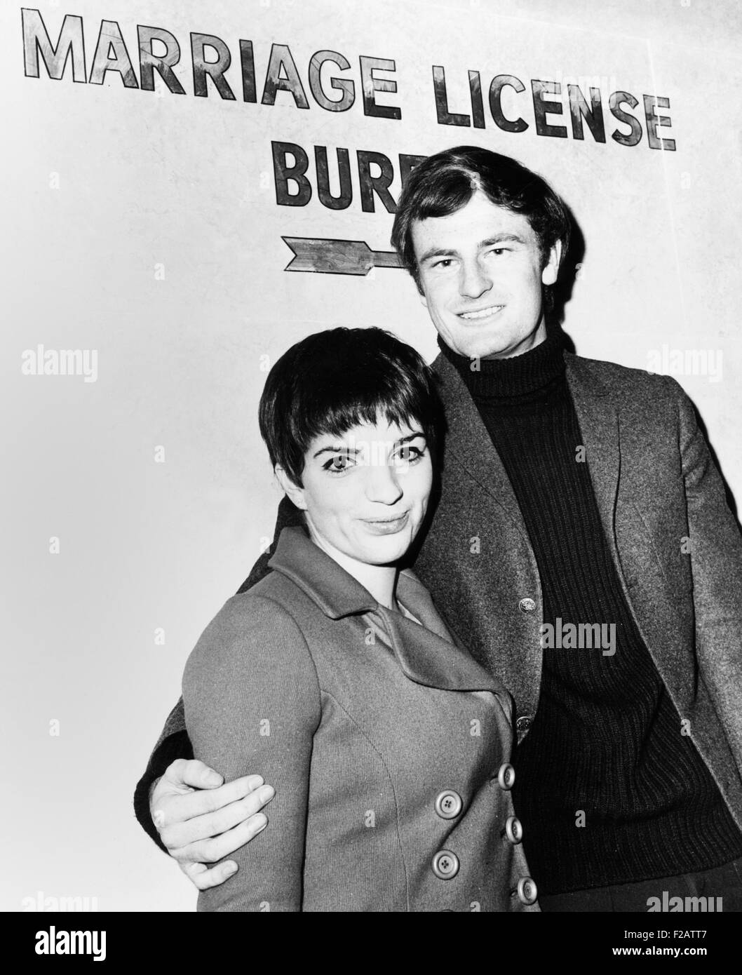 Liza Minnelli and Australian singer Peter Allen at the Marriage License Bureau. New York City, Feb. 20, 1967. The Stock Photo