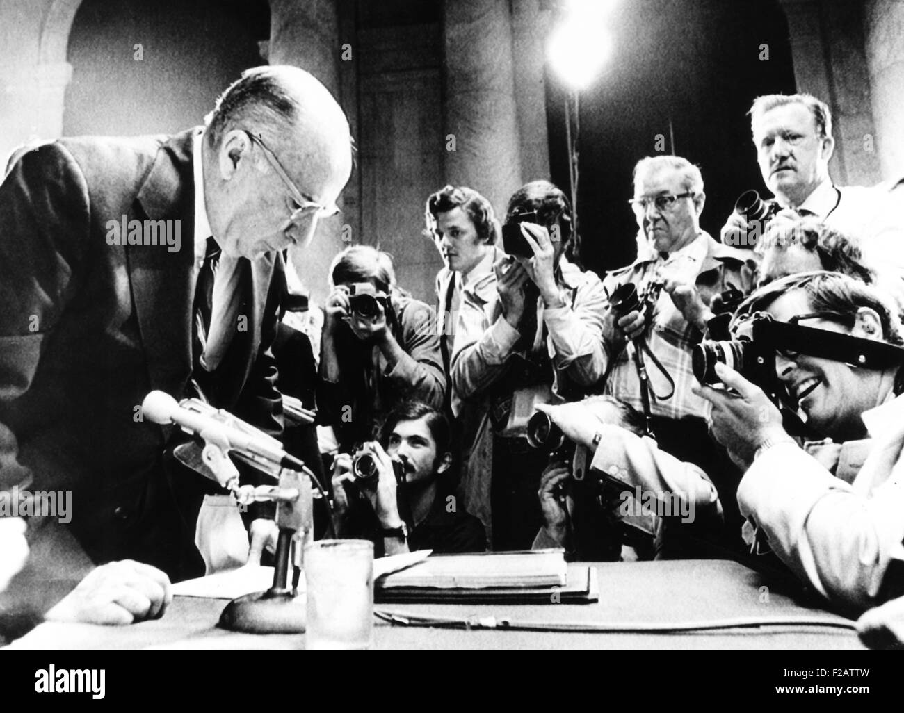 Former Atty. Gen. John Mitchell surrounded by photographers at Watergate hearings. July 10, 1973. He testified that - Stock Image