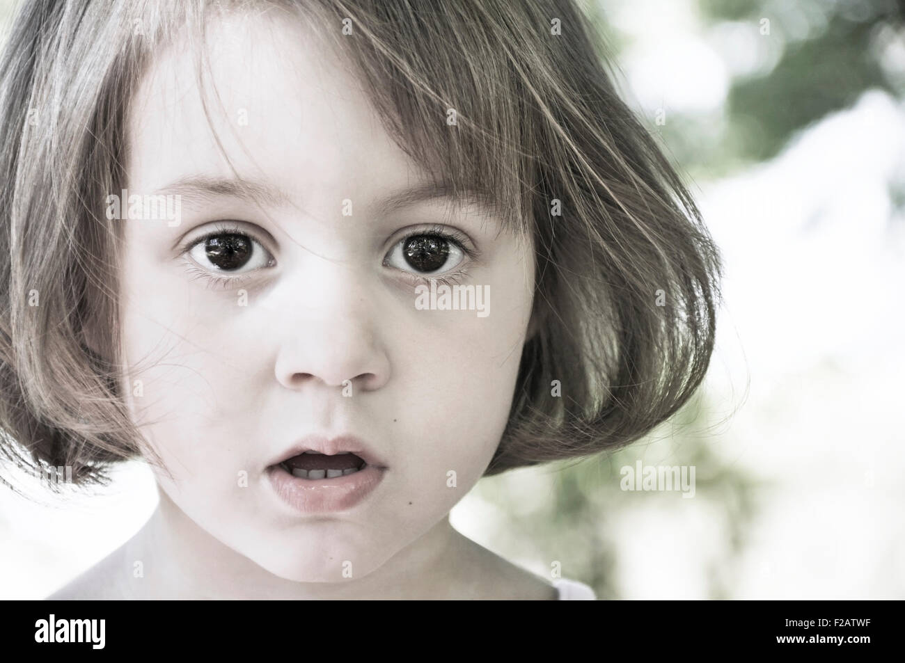Portrait of girl in awe - Stock Image