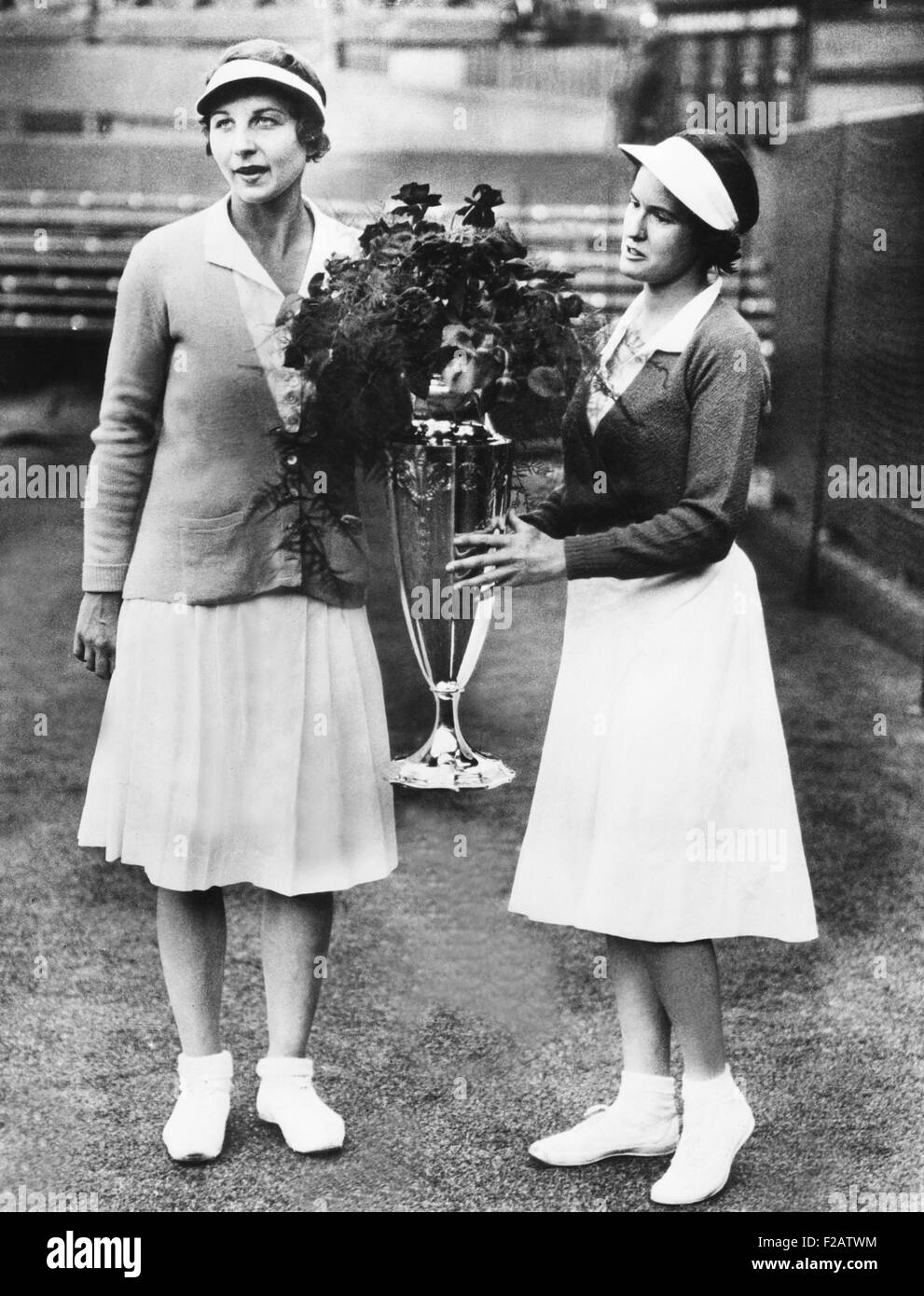 Helen Wills Moody (left) and Sarah Palfrey, with the Wightman Cup. June 20, 1932. The winning doubles partners were - Stock Image