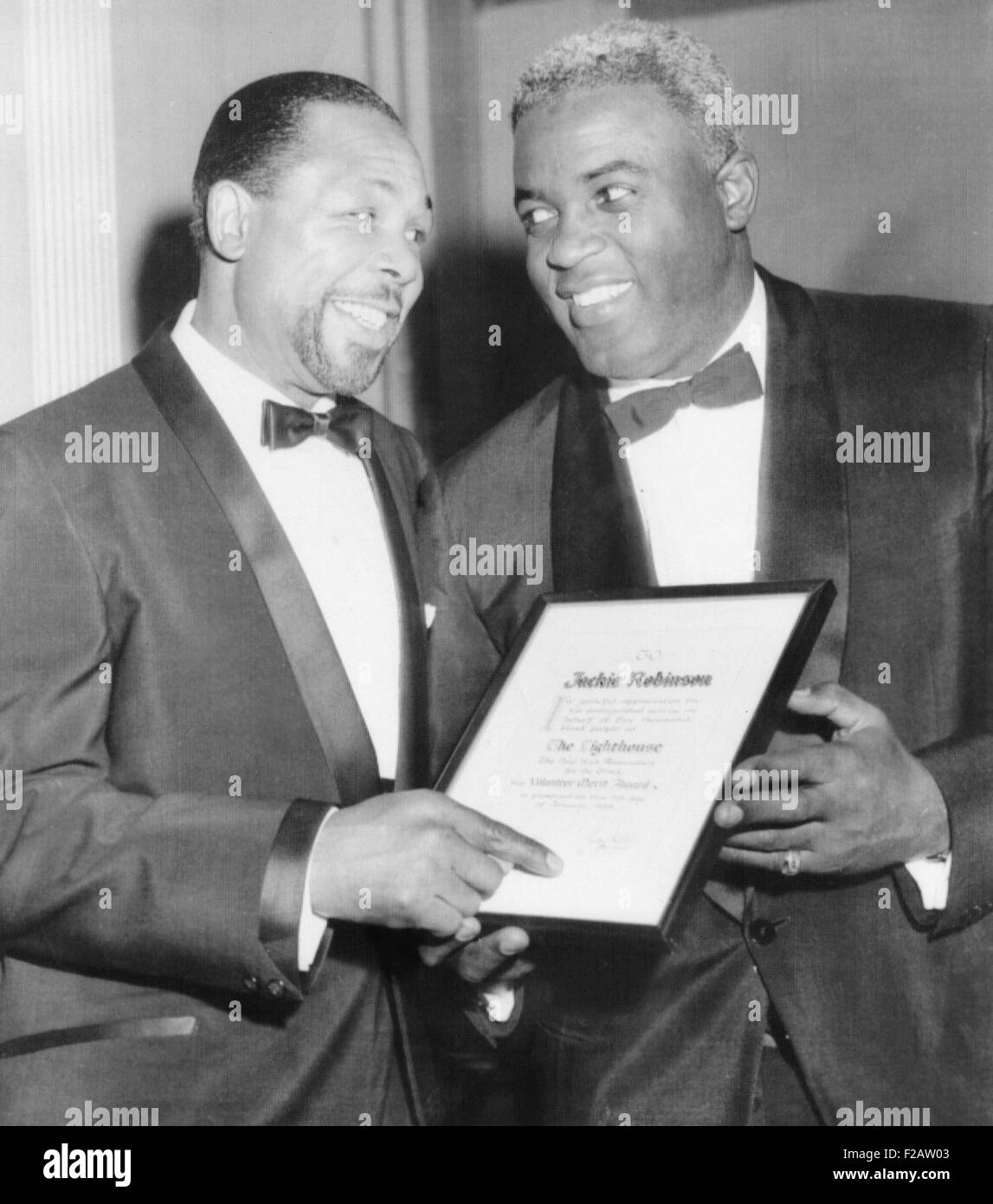 Light heavyweight champion Archie Moore talks with ex-baseball star Jackie Robinson (right).They were at the Lighthouse - Stock Image