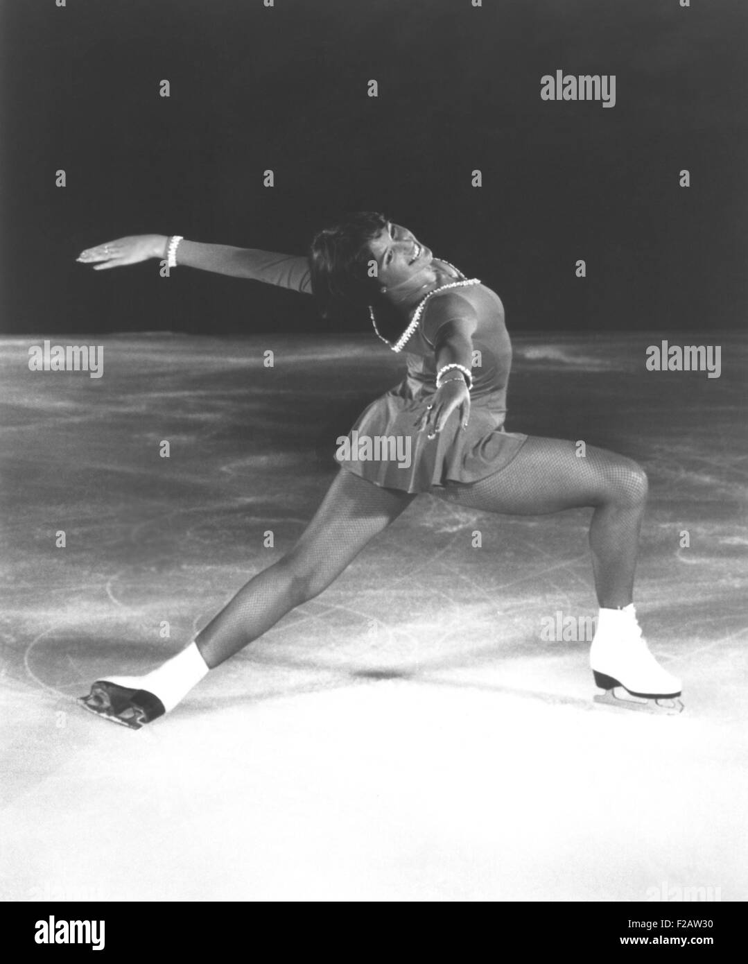 Dorothy Hamill, star skater, performs a 'Ina Bauer' move. 1976 Olympic Gold Medalist skated in ICE CAPADES - Stock Image