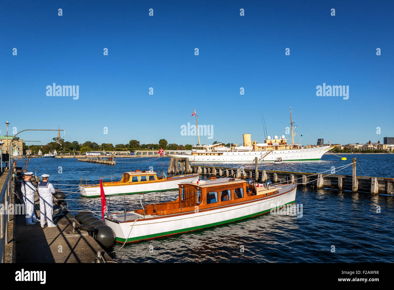 The Royal Yacht Dannebrog and supporting boats in Copenhagen Harbor, Denmark Stock Photo