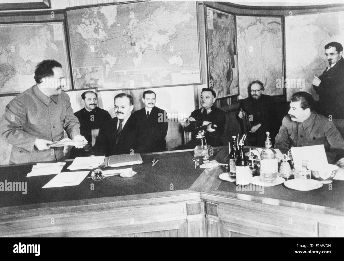 Josef Stalin (seated, right) is shown a 13.787 kilogram gold nugget by G.K. Orjonikioze. Jan 29, 1936, Moscow. The - Stock Image
