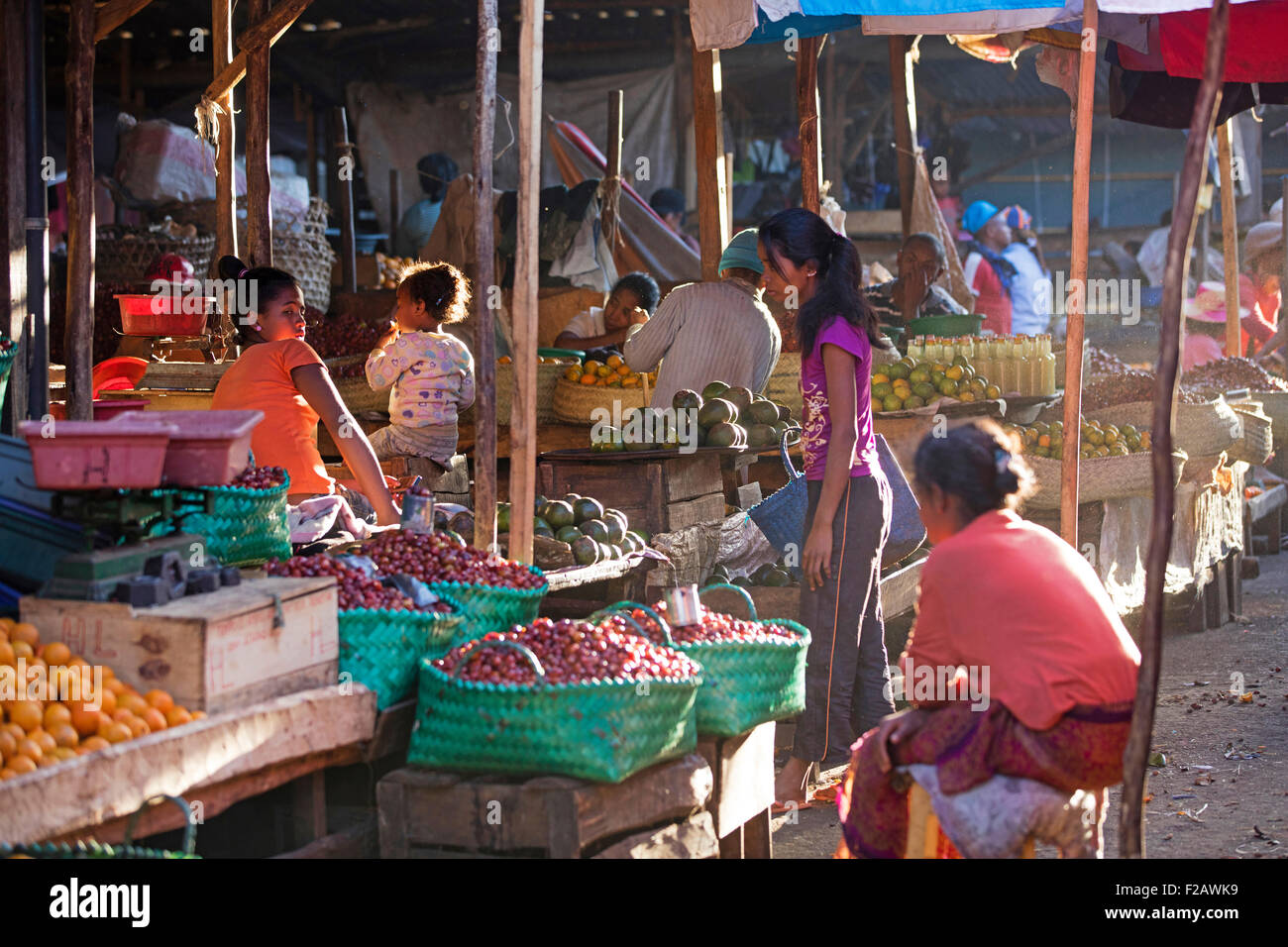 Malagasy street vendors selling fruit and vegetables on daily market in the city Antsirabe, Vakinankaratra, Madagascar, - Stock Image