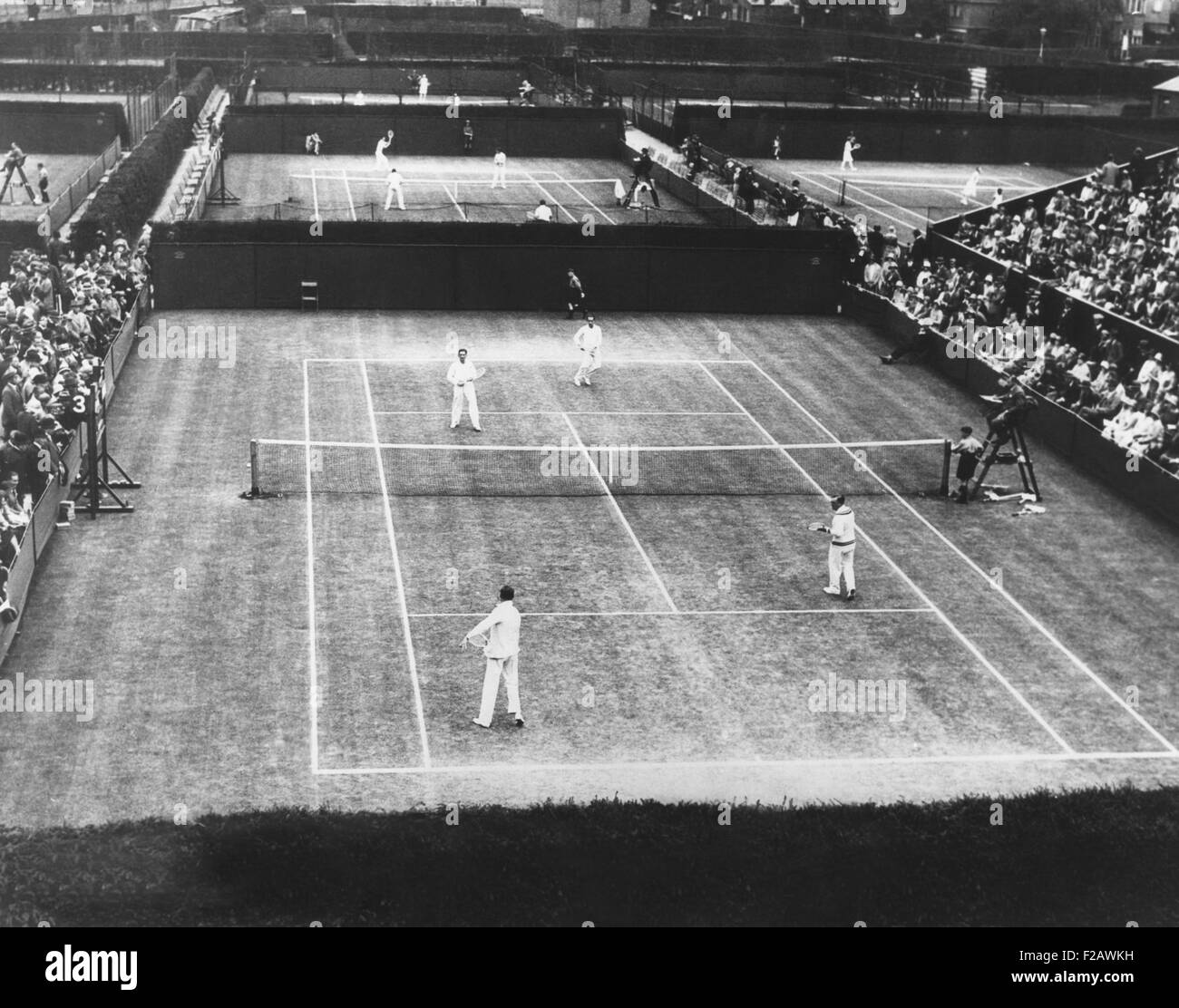 English lawn tennis championship play at Wimbledon, July 2, 1930. In closest court, a double matches was played - Stock Image