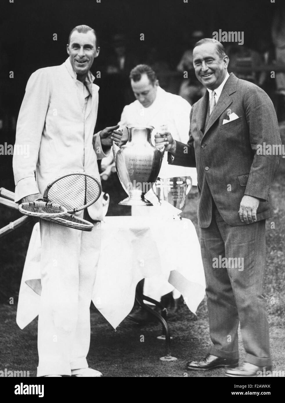 Bill Tilden receives trophy from Samuel Collum, after he won the Men's Singles Championship. Sept 15, 1929. - Stock Image