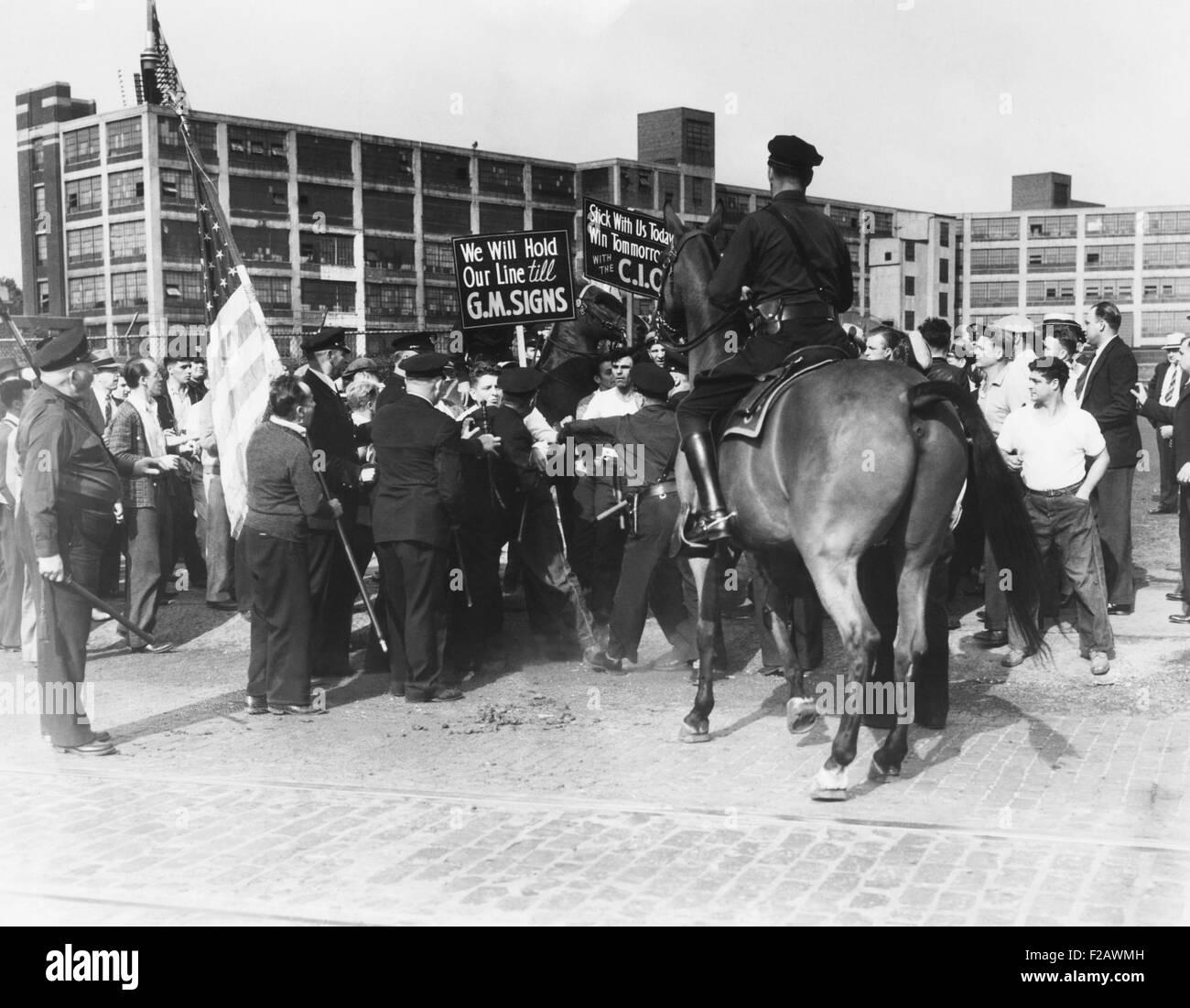 Skirmish between police and strikers at the 'tool and die strike' against General Motors. Detroit, July - Stock Image