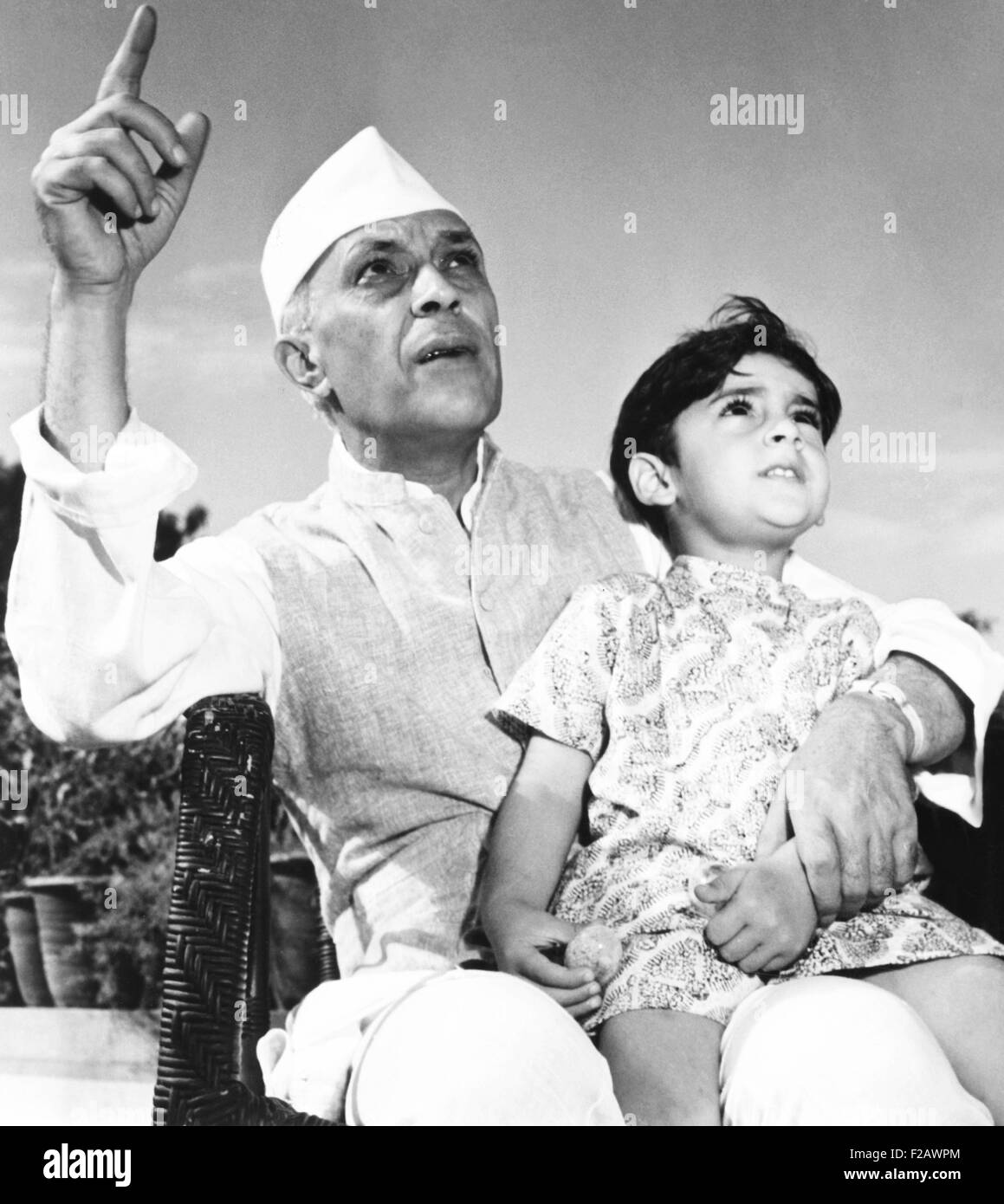 Jawaharlal Nehru, Premier of India, is shown talking with his 3-year-old grandson, Rajiva Gandhi. Rajiva became - Stock Image