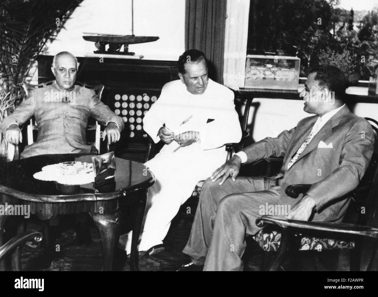 Prime Minister Nehru, Yugoslav President Tito, and Egyptian President Nasser in a conference. July 18, 1956. The Stock Photo