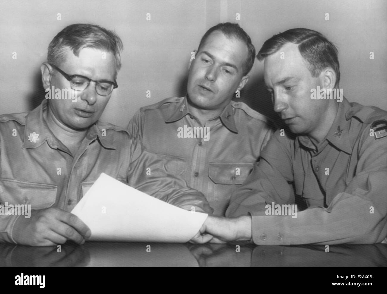 Major Roland E. Alley (center), a 14 year Army veteran, charged misconduct as a Korean War POW. August 22, 1955. - Stock Image