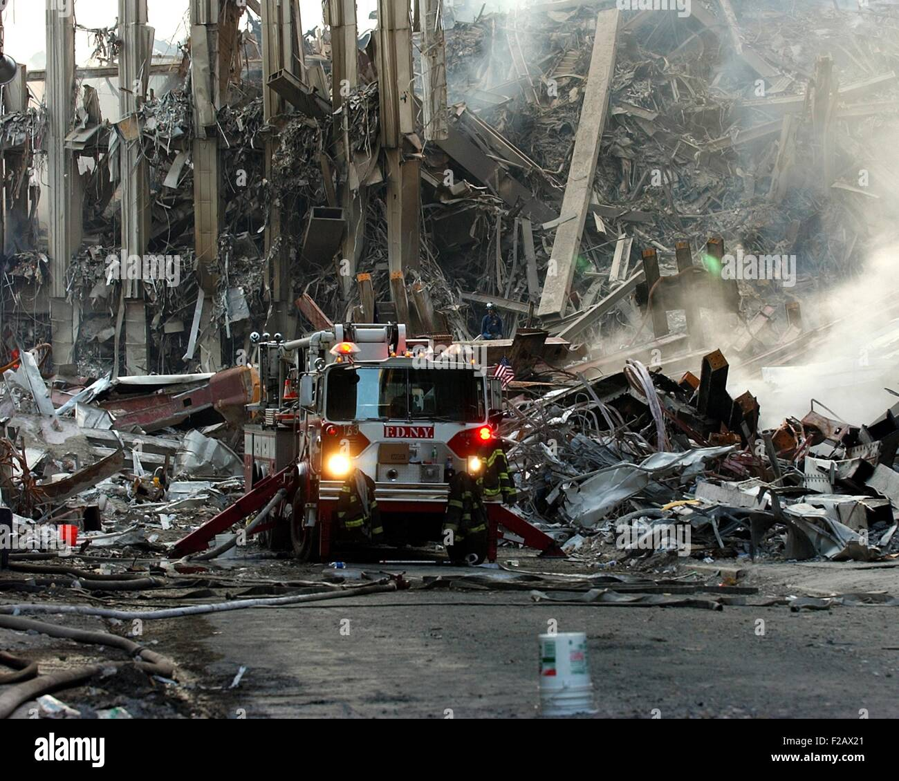 Fire engine by the ruins of the South Tower on Sept 16, 2001. World Trade Center, New York City, after September - Stock Image