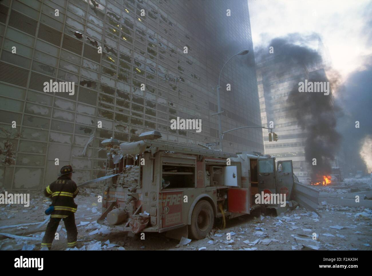 nyc fireman pulling water hose from fire truck after the 9 11 stock photo 87521157 alamy. Black Bedroom Furniture Sets. Home Design Ideas