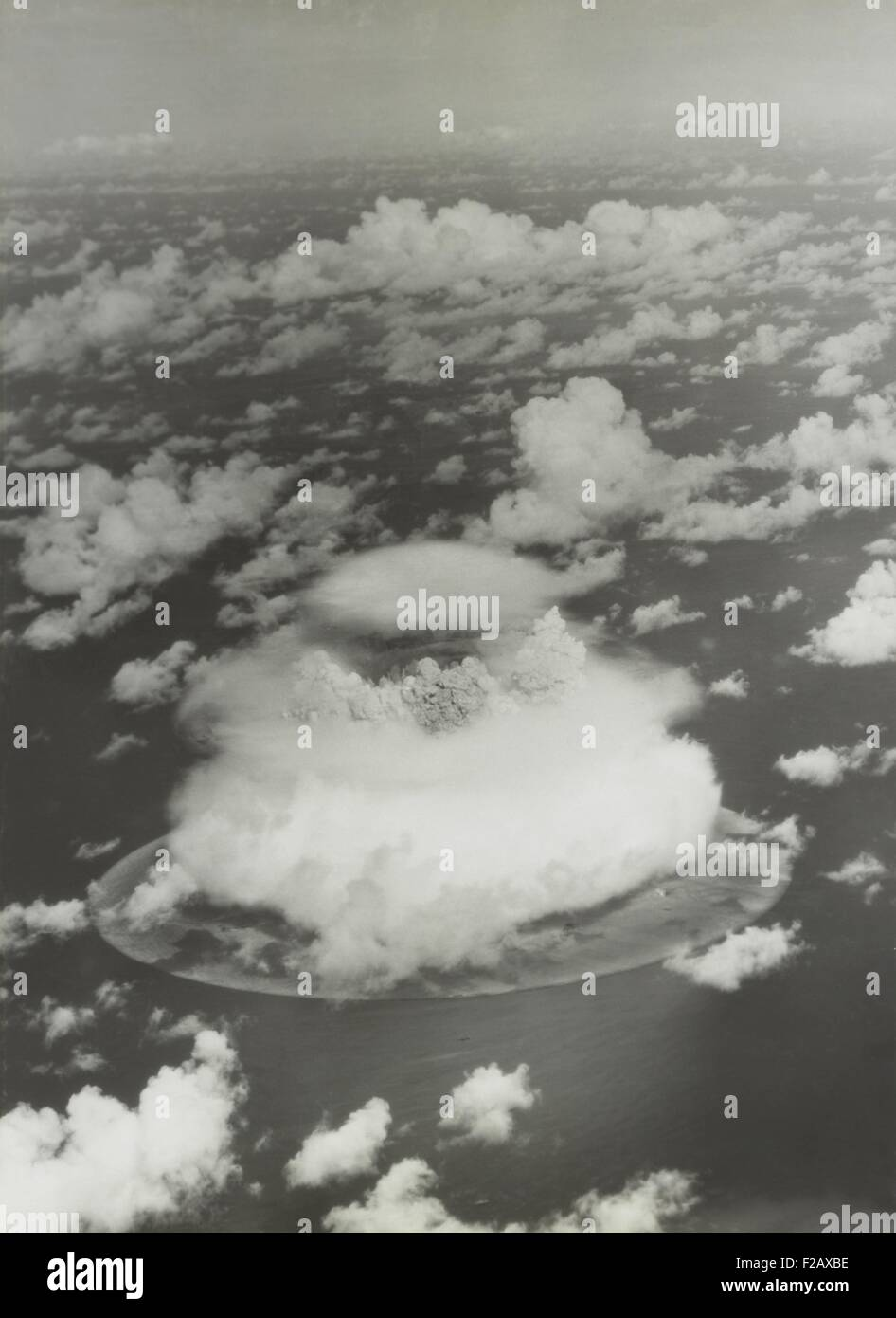 The BAKER test of Operation Crossroads, July 25, 1946. The fireball and water column emerge from the dome of condensation - Stock Image
