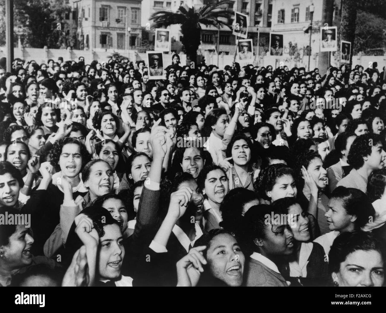 Cairo suffragettes, some carry placards with photographs of Gamal Abdel Nasser. Jan. 22, 1956. The 1956 Egyptian - Stock Image