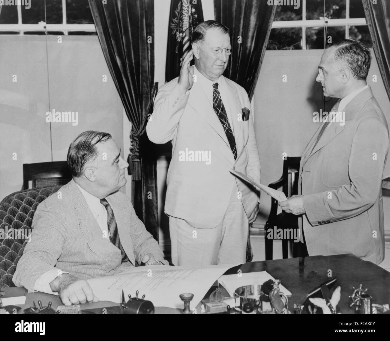 Supreme Court Justice Felix Frankfurter administers oath of office to Secretary of Navy, Col. Frank Knox. As World - Stock Image