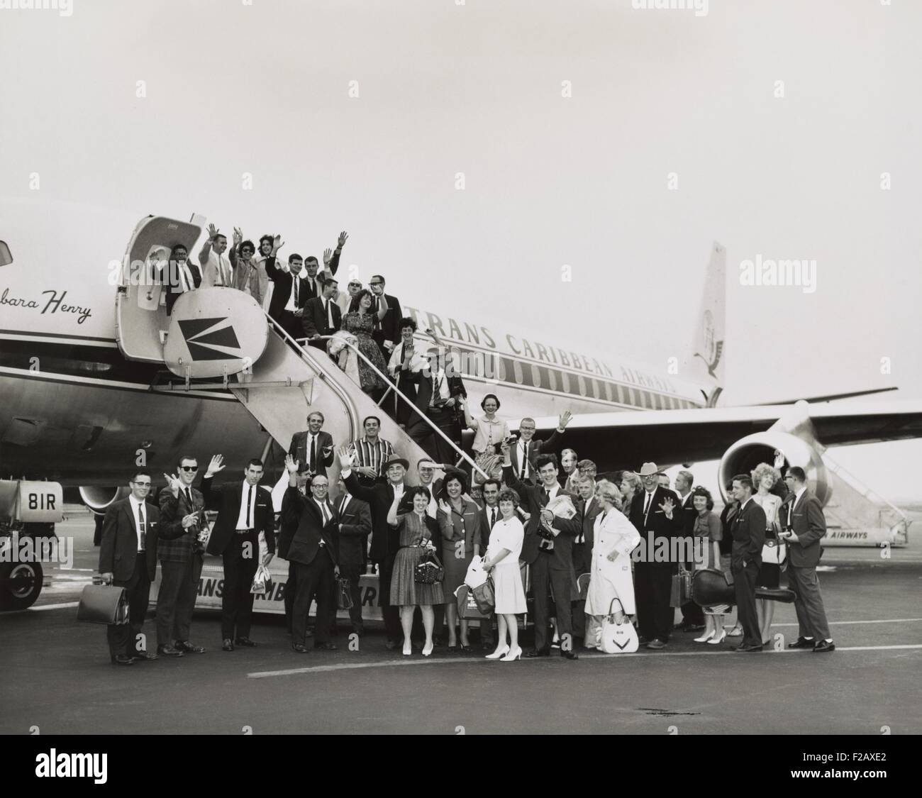 Peace Corps volunteers boarding a Trans Caribbean Airways jet bound for San Juan, Puerto Rico. July 16, 1962. The - Stock Image