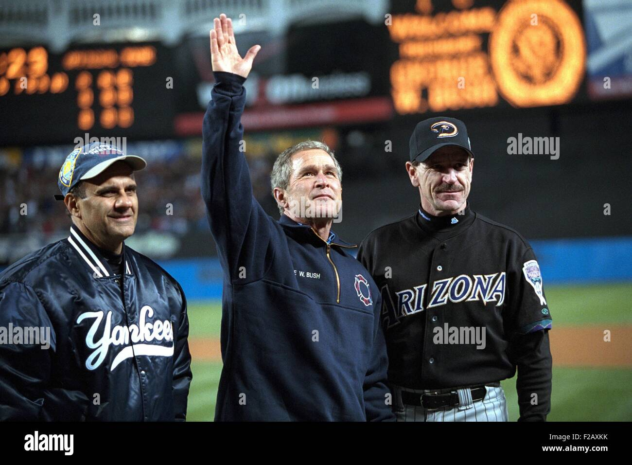 President George W. Bush waves to the World Series crowd at Yankee Stadium. With him are Yankees manager Joe Torre Stock Photo