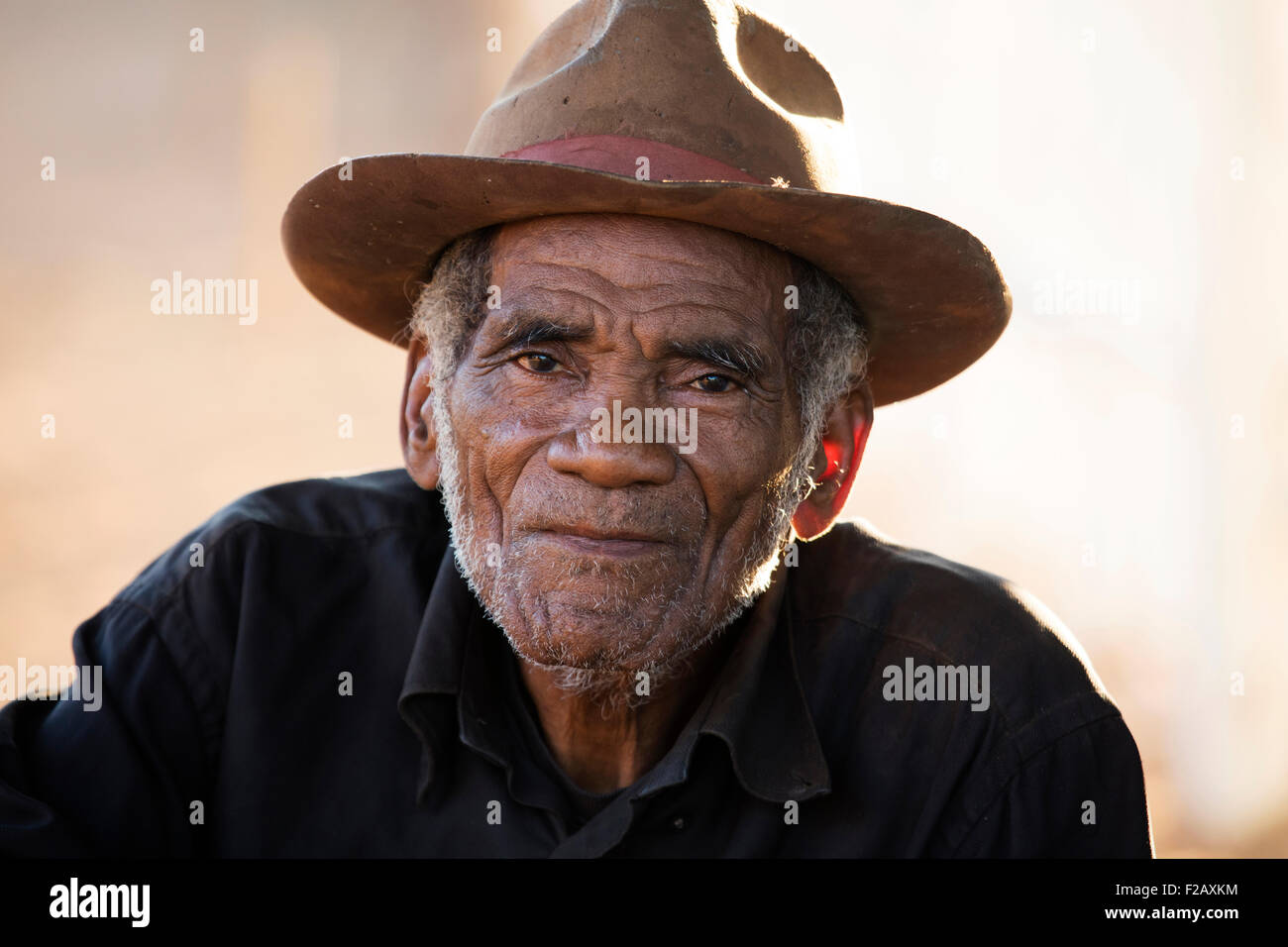 Close up portrait of Malagasy old man with hat in Bekopaka, Antsalova, Melaky, Madagascar, Southeast Africa - Stock Image