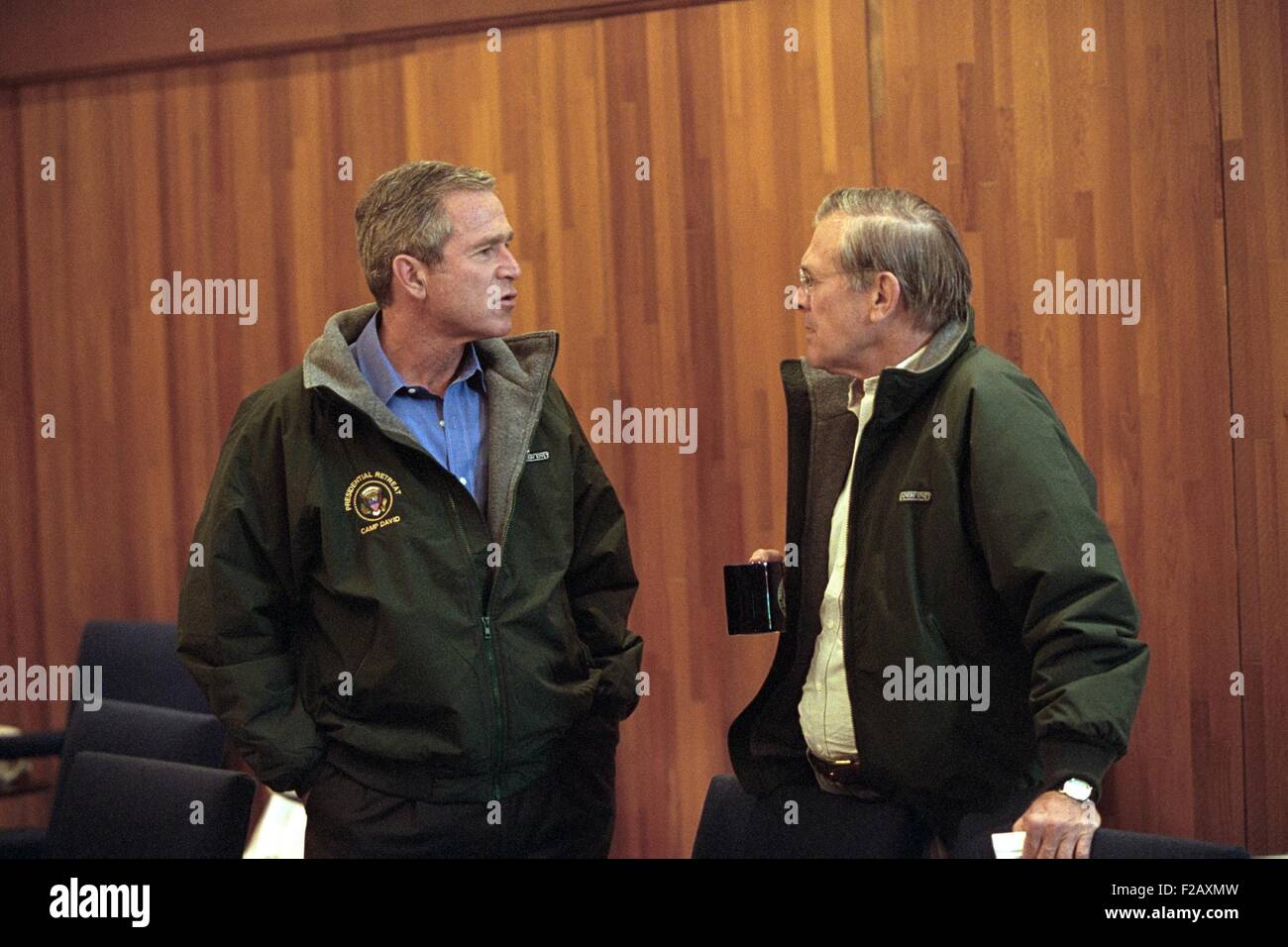 Pres. George W. Bush with Sec. of Defense Donald Rumsfeld, Sept. 15, 2001. They are on a break during a National - Stock Image