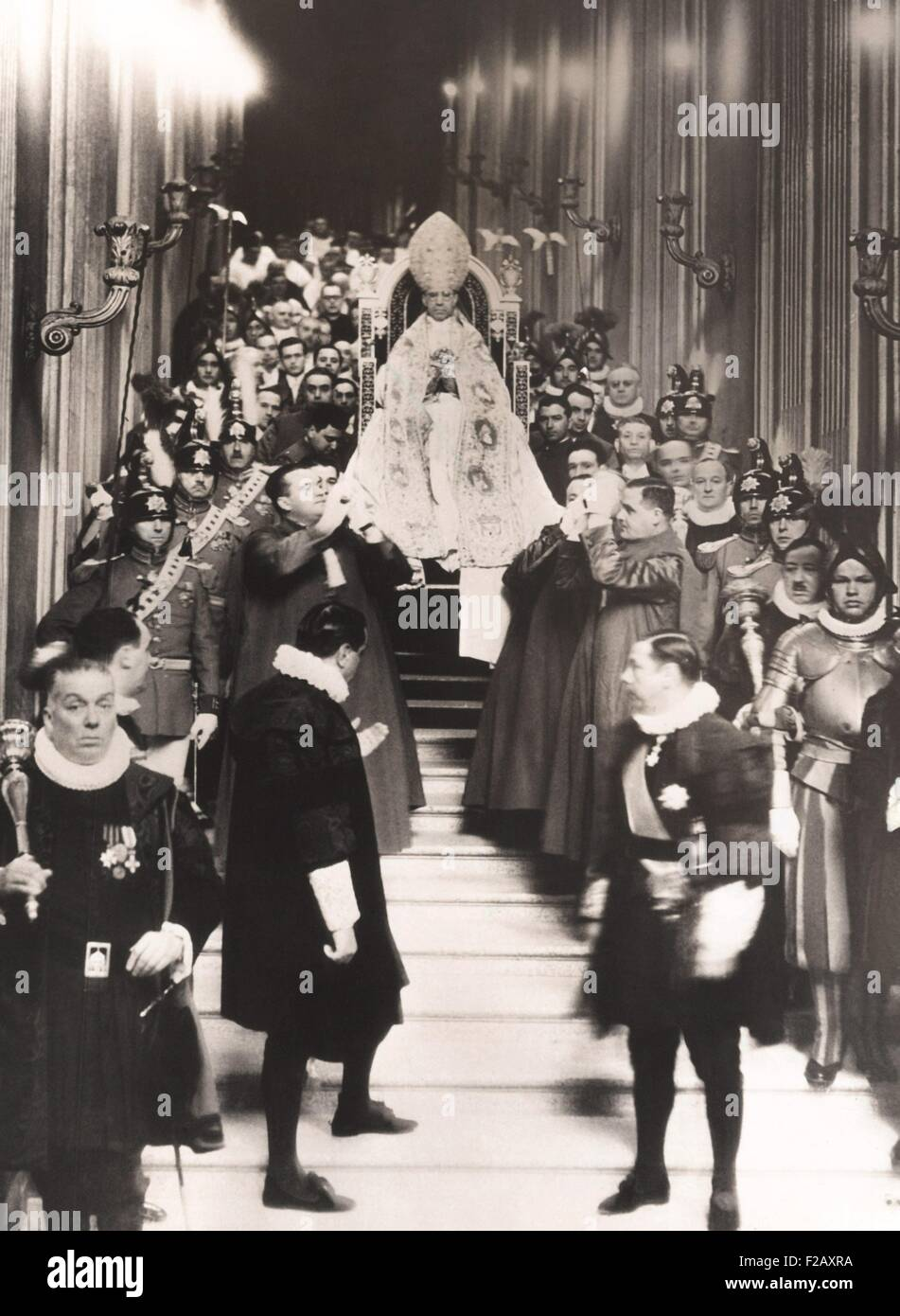Coronation of Pope Pius XII, March 12, 1939. Flanked by Swiss guards and Church dignitaries, Pope Pius XII, was - Stock Image