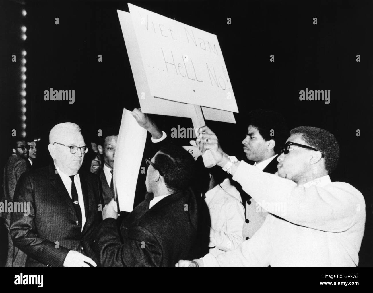 Draft Director Louis Hershey driven from the stage by anti-war protestors at Howard University. March 21, 1967. - Stock Image