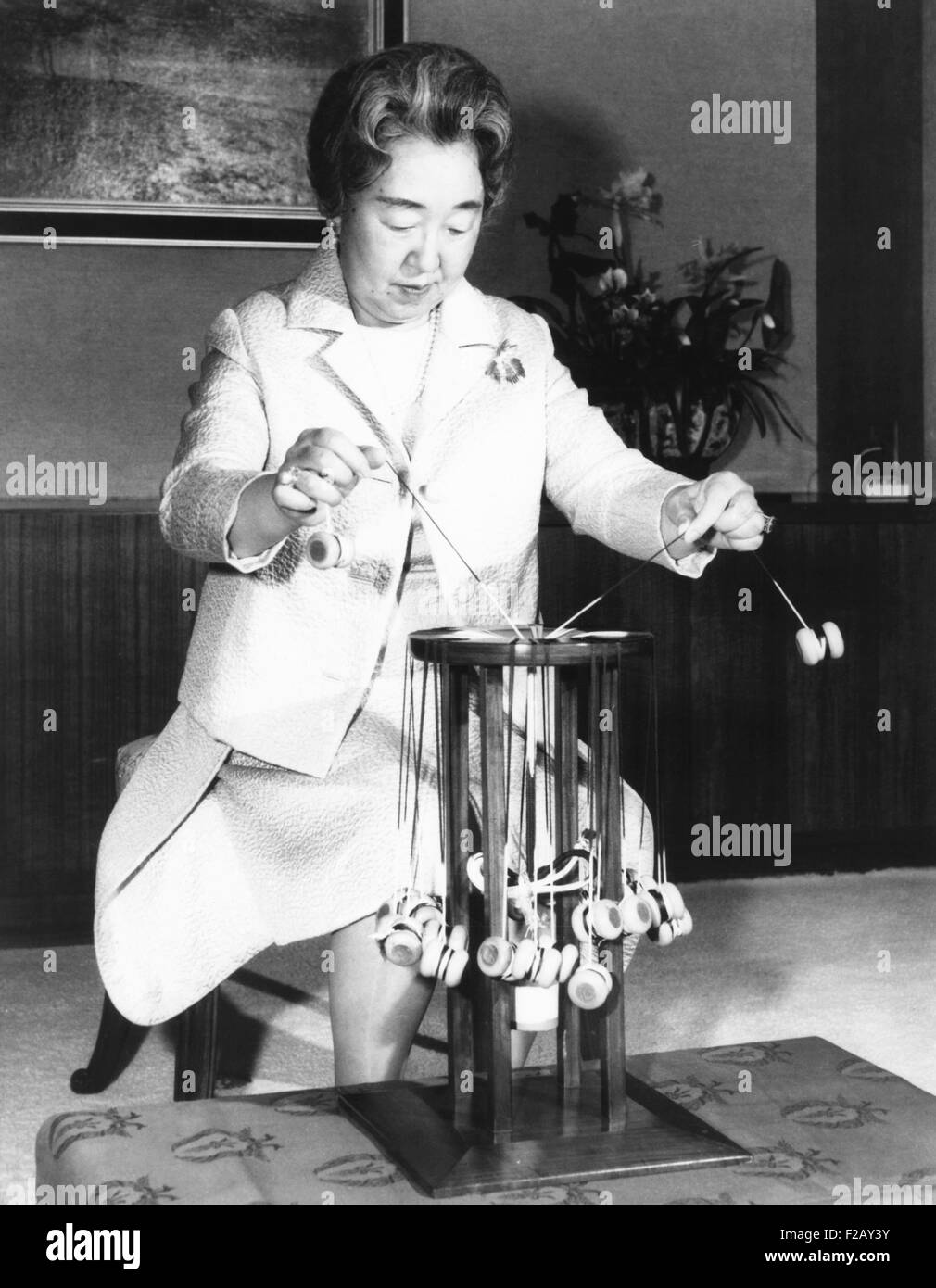 Japan's Empress Nagoto, weaving on a manual braiding machine at the Imperial Palace. March 17, 1971. The braids - Stock Image