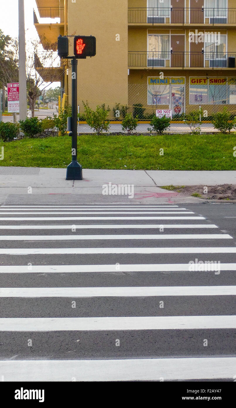 "Zebra crossing with a red ""wait"" signal in Orlando, Florida Stock Photo"