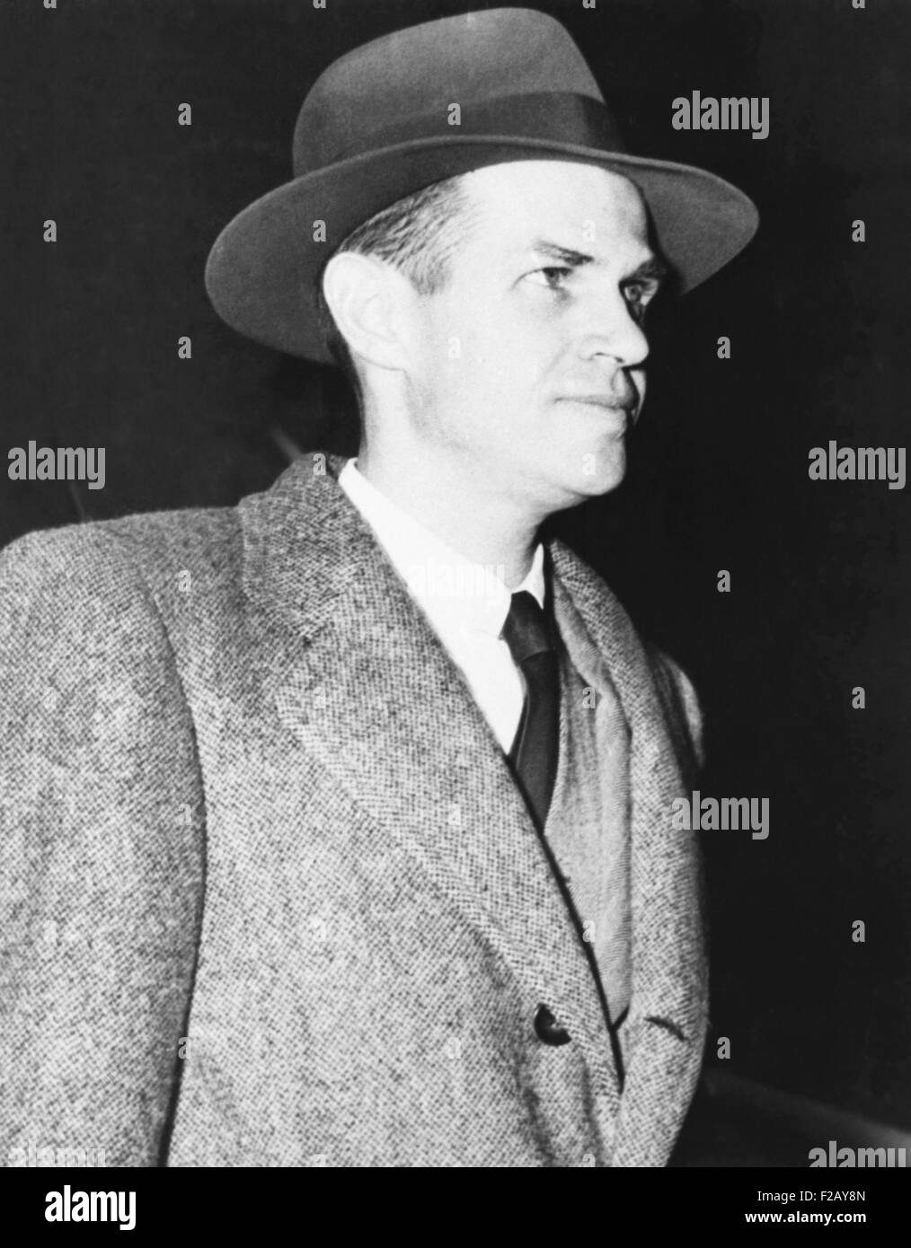 Alger Hiss in front of the Federal Courthouse in New York, Nov. 17, 1949. The former State Department employee was - Stock Image