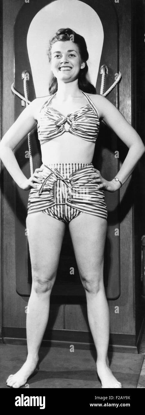 Model in a 1946 striped glazed cotton chintz bathing suit. It was exhibited at the International Sportsman's - Stock Image