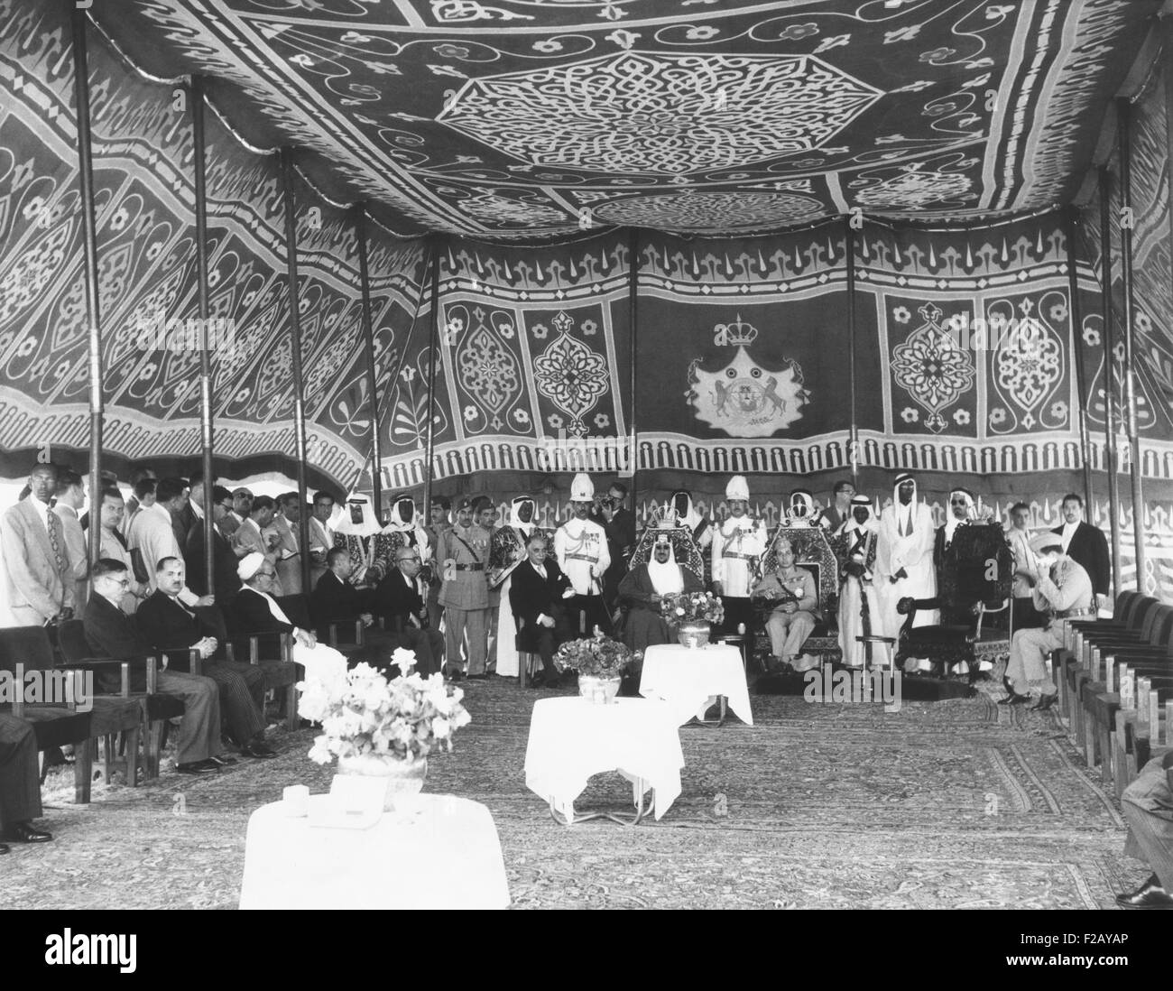 Inside a richly tapestried tent, Iraq's King Faisal meets with King Saud of Saudi Arabia. May 14, 1957. The - Stock Image