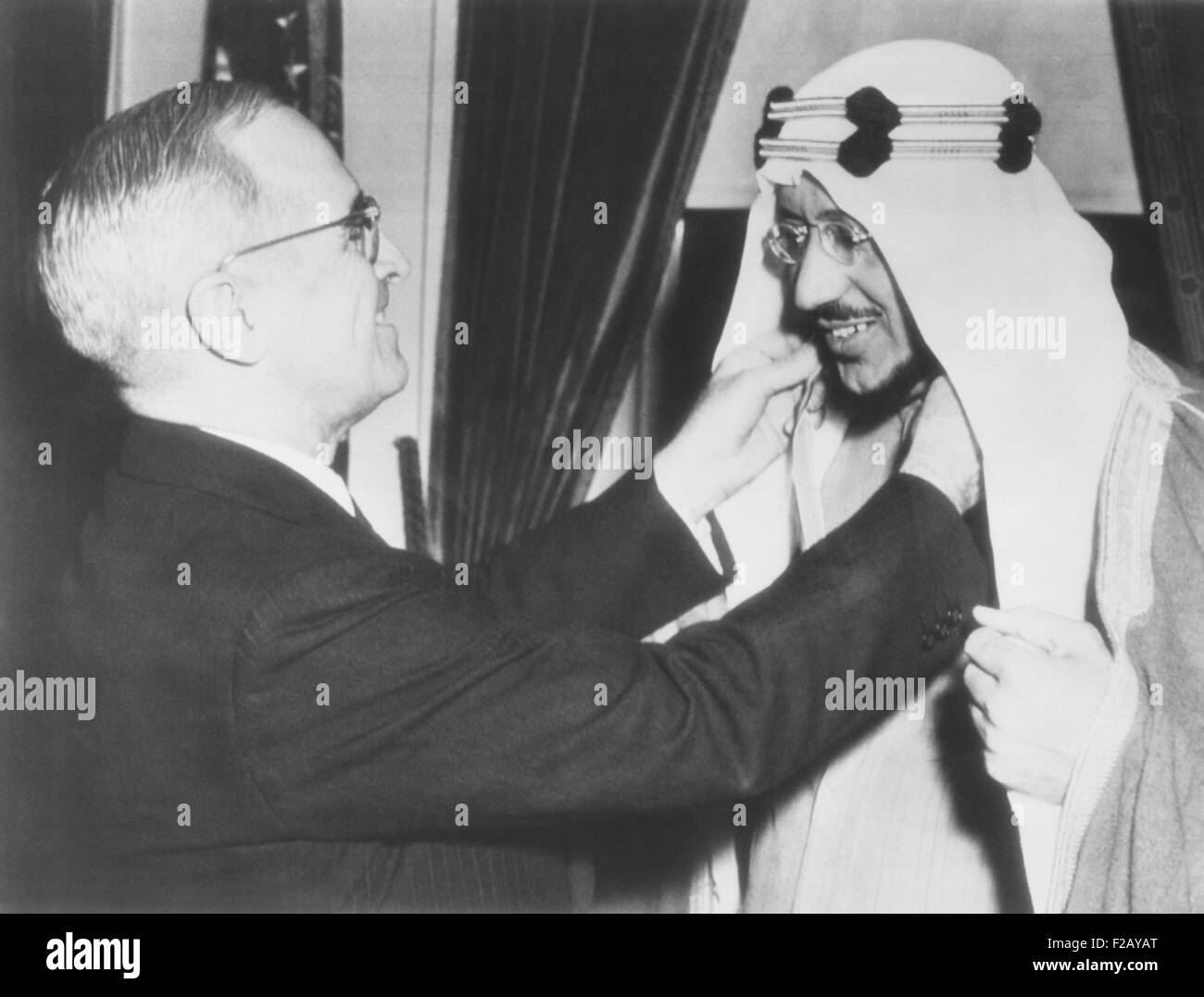 President Harry Truman presents the Legion of Merit to Crown Prince Amir Saud of Saudi Arabia. Feb. 18, 1947. In - Stock Image